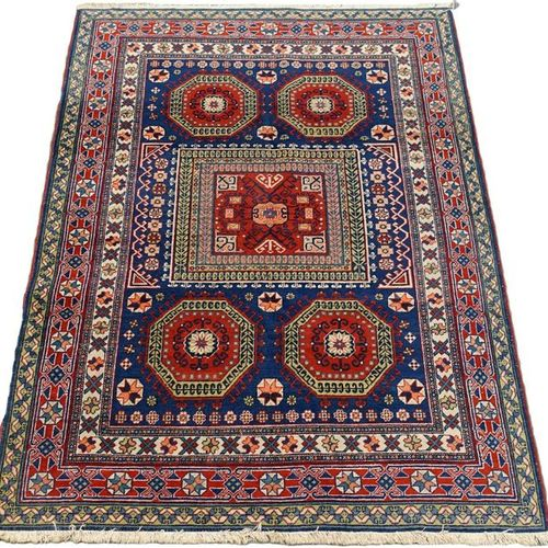 Carpette Caucase. The background, midnight blue, features hooked medallions and …