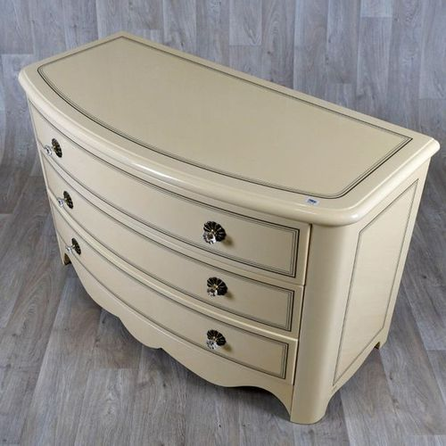 Jean Claude Mahey Commode. Curved front releasing three large drawers with frame…