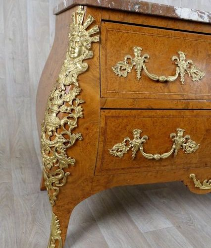 Commode de Style Régence. Topped with a red marble with white veins. The curved …