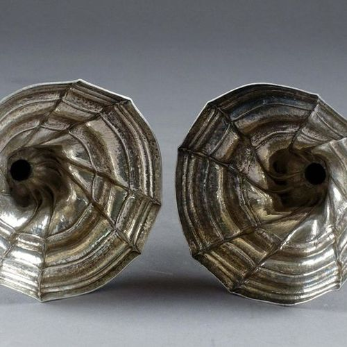 Paire de Flambeaux. Round feet, round bent legs. Baluster barrel and torsos ribs…
