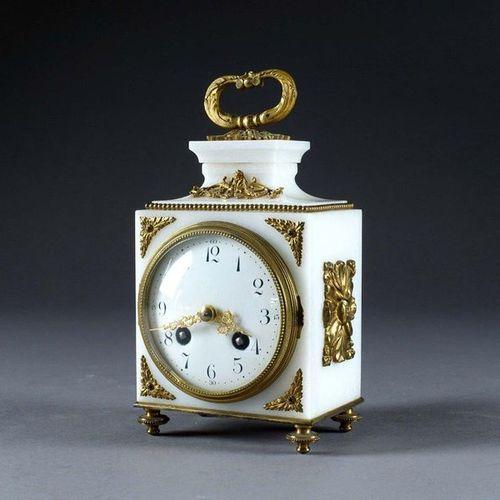 Petite Pendule de Table Louis XVI, de Forme borne. White marble and gilt bronze,…