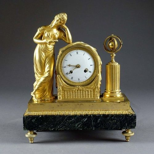 France, d'époque Restauration. Reading clock, animated by a young woman reading …