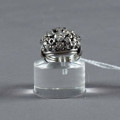 Bague de Dame. Set with a central old cut diamond (approx. 0.30 carat) enhanced …