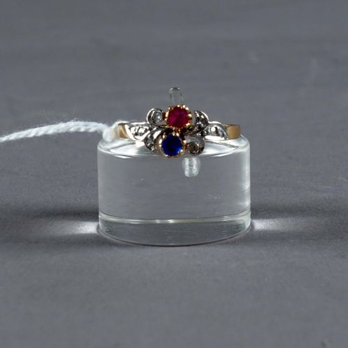 Bague de Dame. Set with one ruby and one round cut sapphire (approx. 0.40 carat)…