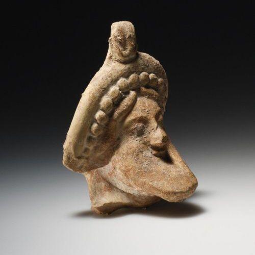 A Head of Dionysos or of a Symposiast Grèce occidentale, environ 500 avant J. C.…