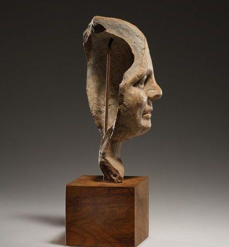 A Fragment of a Child's Head Etrusque 3 2ème cent. B.C..  Terre cuite. H. 16,6 c…