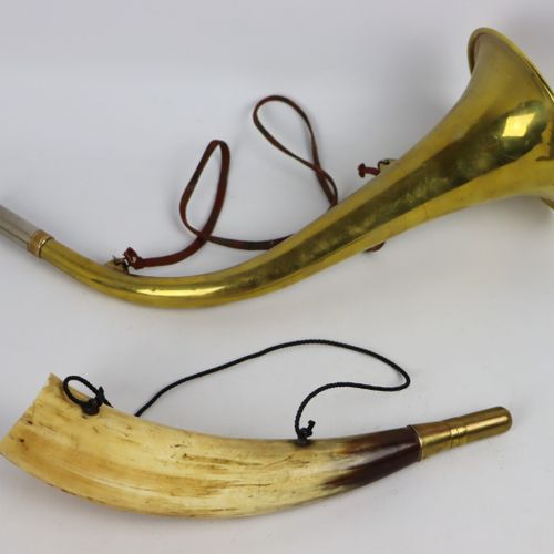 Two hunting horns, one made of brass, the other of horn and brass.  L_35 cm and …