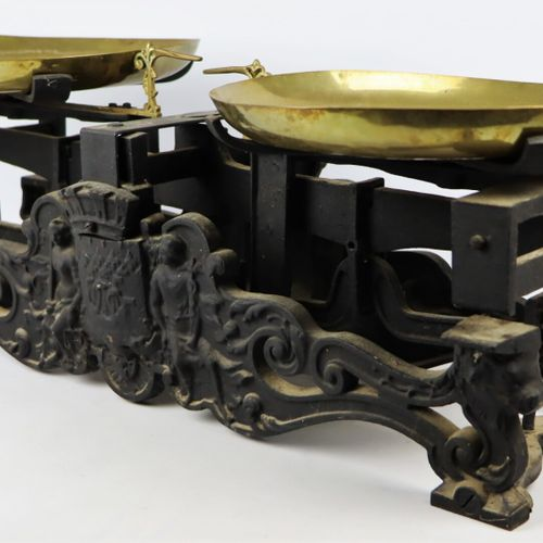 Roberval type seed scale, on a cast iron base richly decorated with the coat of …