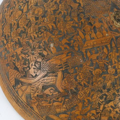 Important half calabash engraved with village scenes.  Peru, early 20th century.…