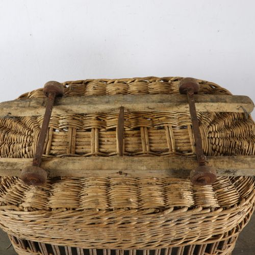 Baker's bread trolley made of wood and woven wicker, on wheels.  Plate from a ma…