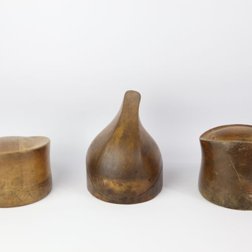 Collection of eight carved wooden marottes and hat forms.  L_16 cm to 28.5 cm
