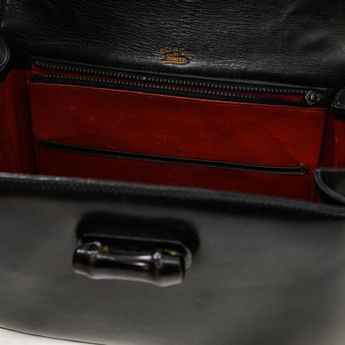 Gucci Sac à main Gucci Bambou    En cuir lisse noir, 1964.  Intérieur rouge, poc…