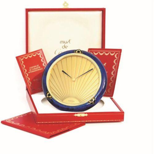 Cartier, Lapis Art Deco, circa 1990  Beautiful Art Deco style gilded metal table…