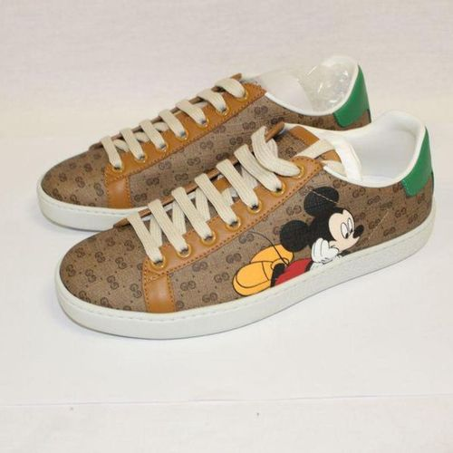 """GUCCI X DISNEY by Alessandro Michele     Pair of laced """"Ace"""" sneakers in co…"""
