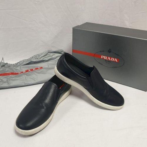 PRADA     Pair of black calfskin briefs with white rubber soles. T.6. Good …