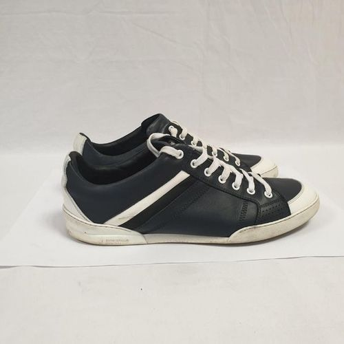 DIOR Man     Pair of laced runners in black and white leather, rubber soles…