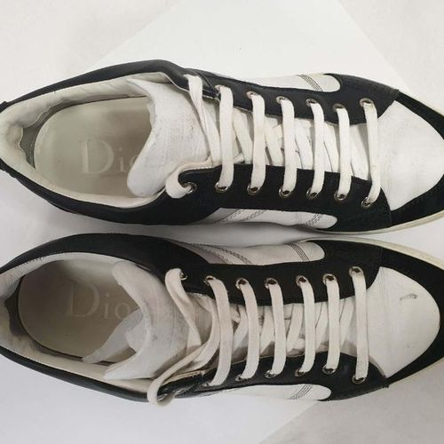 DIOR Man    Pair of laced runners in white and grey leather and black suede,…
