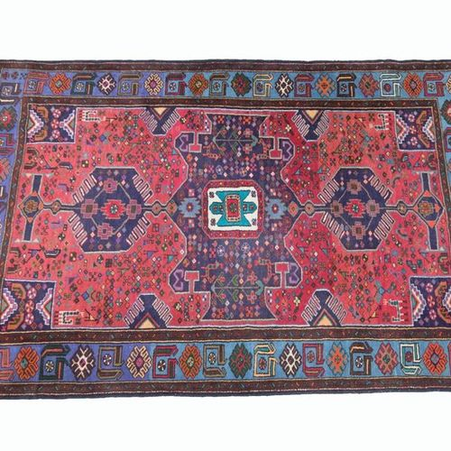 Woollen carpet, decorated with a central polygon on a red background decorated w…