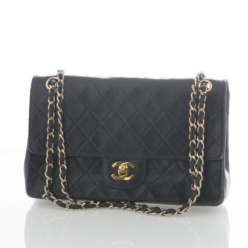 CHANEL. Timeless bag in black quilted lambskin leather, red lining, adjustable s…