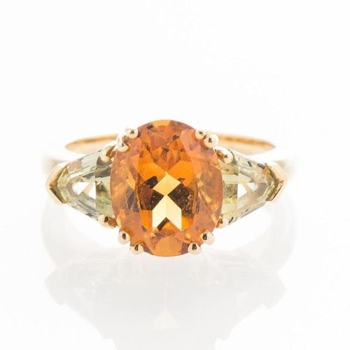 Yellow gold ring 750 thousandths set with a citrine oval size of about 3.5 ct, s…