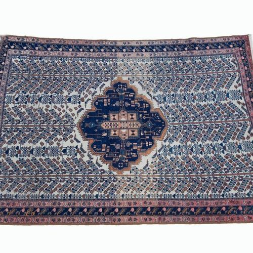 Woollen rug decorated with a central polygon and stylised trees of life on a bei…