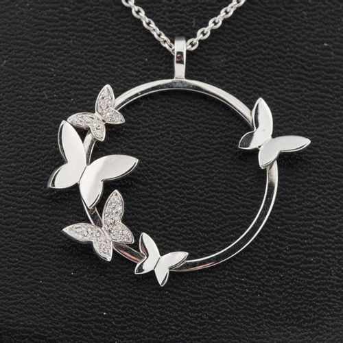 Chain and pendant in 750 thousandths white gold featuring five butterflies movin…