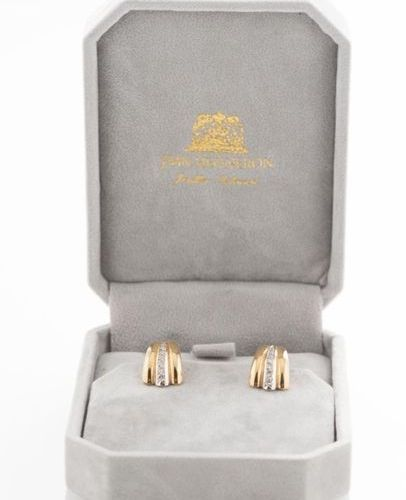 Pair of 750 thousandths yellow gold ear clips adorned with a line of diamonds. I…