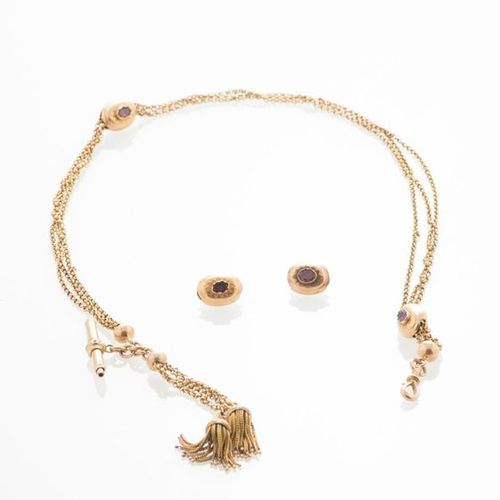 Watch chain and key in 750 thousandths yellow gold, decorated with two charms ce…