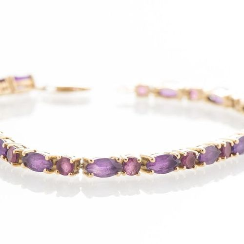 Yellow gold bracelet 750 thousandths set with a line of alternating rhodolites a…