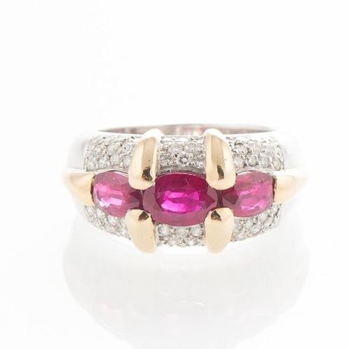 White and yellow gold 750 thousandths ring set with three oval cut rubies and a …