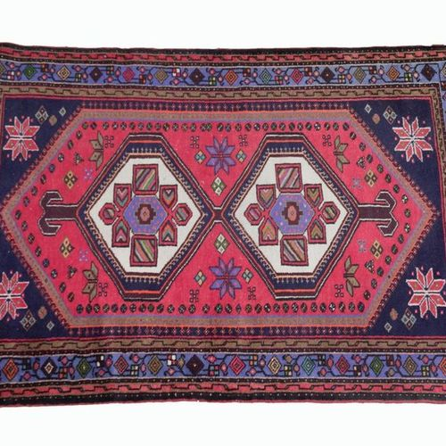 IRAN. Woollen rug decorated with two polygons on a red background, spandrels dec…