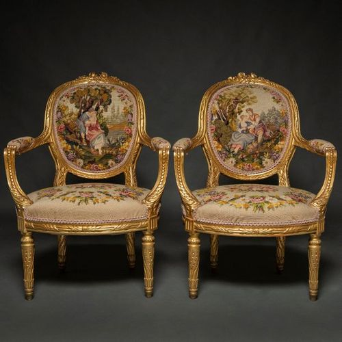 Pair of Louis XVI style French armchairs in carved and gilded wood. French work,…