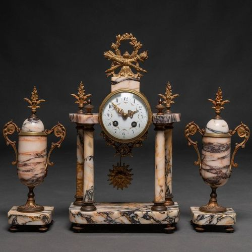 French table clock with Louis XVI style marble cups. French work, XIX Century Cl…