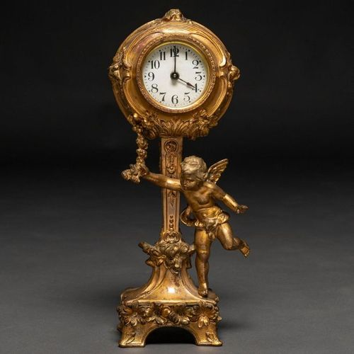 French Louis XVI style table clock in gilt bronze. XX Century 32x 7 x 11 cms. De…