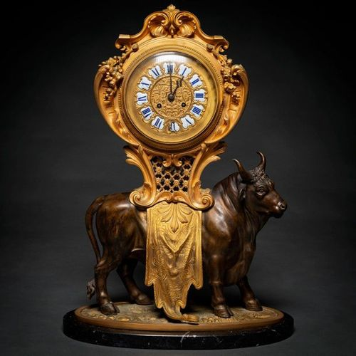 Important French Napoleon III table clock in gilded and blued bronze. XIX Centur…
