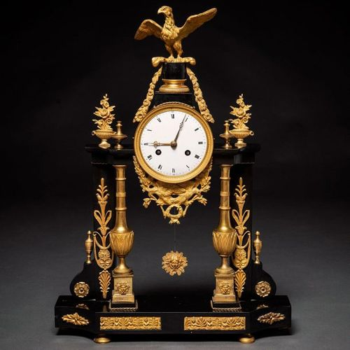 French table clock from the Louis XVI period in gilded bronze and black marble. …