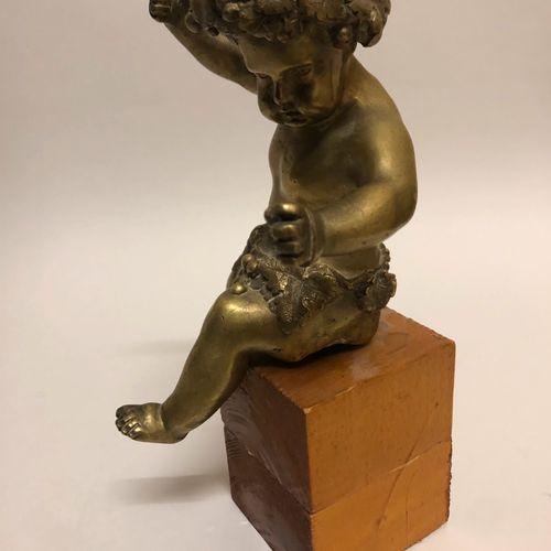 Petit BACCHUS en bronze doré. Haut.: 16 cm. (élément de récupération)