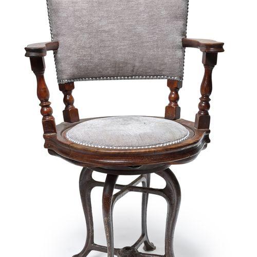 FRANCE, fin XIXème siècle Captain's chair in exotic wood on four cast iron legs,…