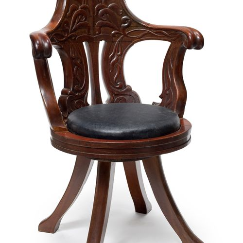 Pair of solid carved mahogany boat armchairs with four legs Circa 1900 H. 90 cm
