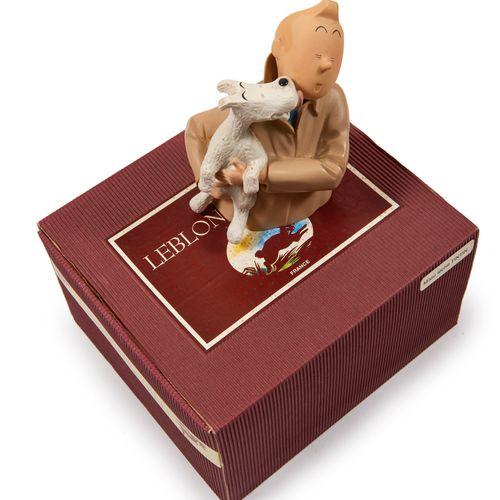 Leblon Delienne Milou lèche Tintin: Figurine représentant Milou dans les bras d…