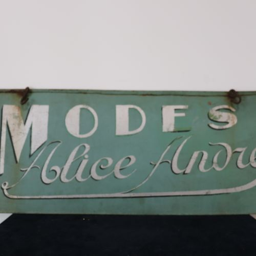"A sheet metal advertising plate ""Mode Alice André"" H34 x W79cm"
