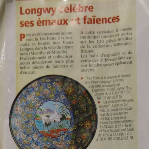 Longwy dish with floral decoration in its center couple of waders on a backgroun…