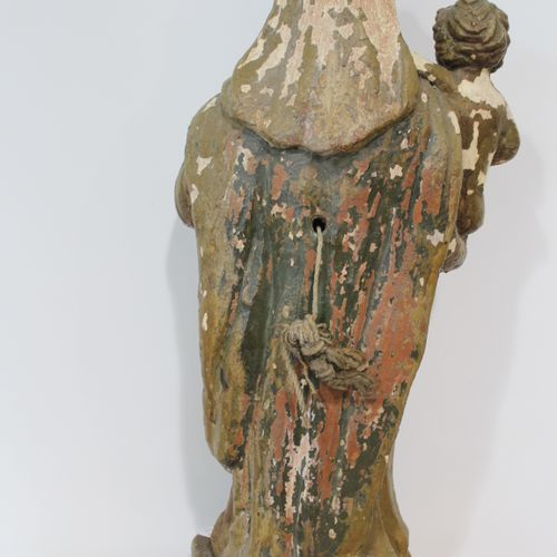 An old terracotta Virgin and Child Height 60 cm