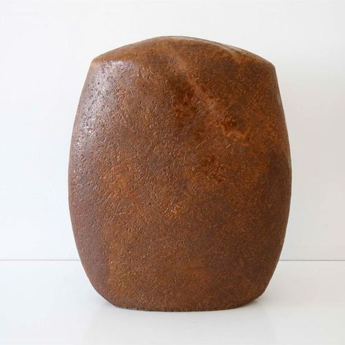 DEBRIL Claire (b. 1927) Ovoid pebble sculpture in terracotta with flattened bell…