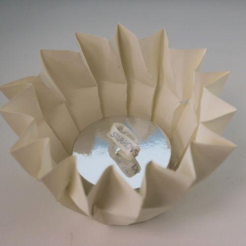 """Swarovski """"Aura"""".  White metal pendant set with Swarovski diamond crystals conta…"""