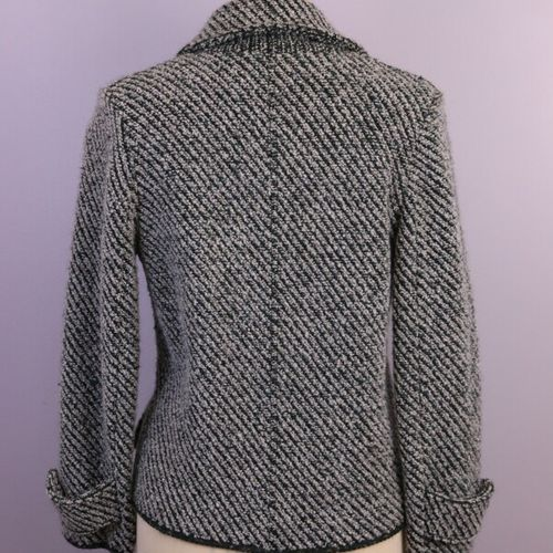 CARVEN  Blue, black, red tweed pea jacket, closing with a button and a snap fast…