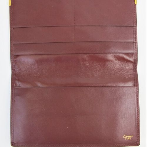 CARTIER Must de Cartier  Burgundy calf leather checkbook holder, monogrammed dou…