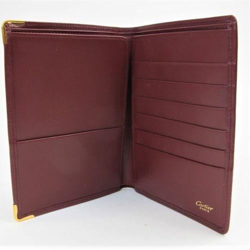 CARTIER Must de Cartier  Passport holder in burgundy calf leather, monogrammed d…