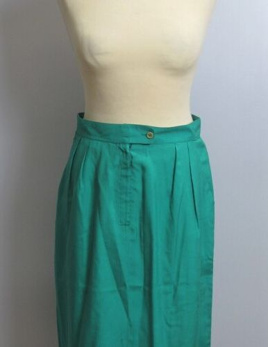 APOSTROPHE  Straight skirt in green silk, zip and button front, side pockets  Si…