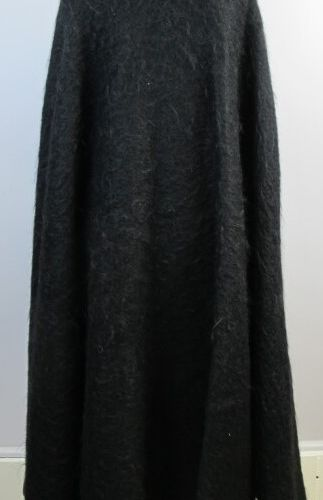 Cape in boiled wool, closing with a press stud and three buttons.  One size fits…